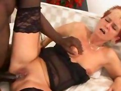 Mature bitch trying to swallow a big black cock