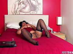 Stunning brunette momma with huge bazongas in stockings plays with herself in bedroom