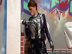 Glamorous girl playing with a bukkake toy at a gloryhole