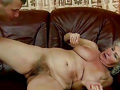 Busty granny getting her hairy pussy fucked