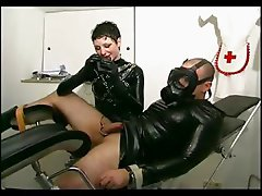 Slave girl jerking a masters cock