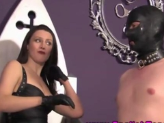 Femdom puts her sub in leather mask and binds him