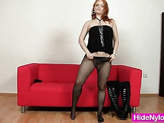 Redhead hottie pulling nylon nylons out her hole