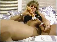 Busty Hermaphodite plays with toy