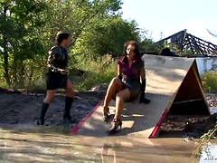 lesbian babes get completely soaked in mud