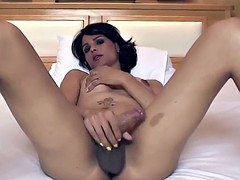 Hot Latina shemale pulls out her cock and masturbates