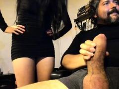 Pretty Oriental babe sucks and strokes a fat cock on webcam