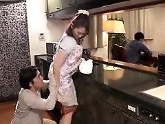 Desirable Oriental milf enjoys doggystyle sex in the kitchen
