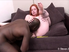 Fat redhead has a big black cock providing intense orgasms