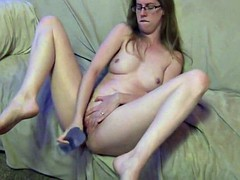 Milf plays with her dildo and squirt