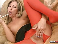 Beauty in pantyhose rips them and masturbates