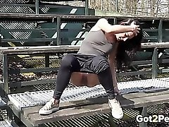 Sporty girl takes a piss in public