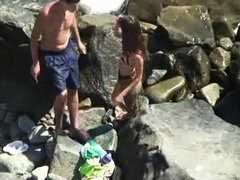 Beach voyeur spies on a sexy brunette teen and her boyfriend