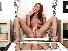 Stunning beauty licks her piss off a table