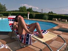 Sporty teen with a shaved honeypot plays by the pool
