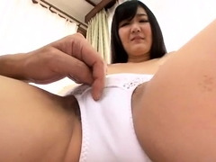 Slim Japanese babe gets her hairy twat fingered and fucked