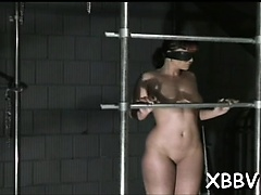 Pliant female endures harsh treatment in bdsm show
