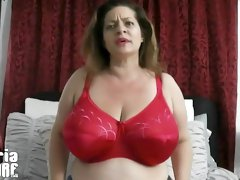 Huge boobs get released from a red bra