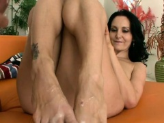 MILF uses her feet on a cock