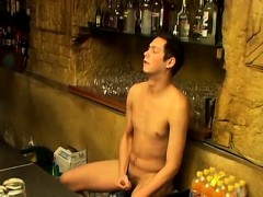 Cute horny twink Christian jerks his massive prick in a bar