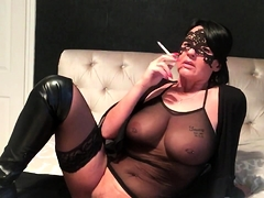 Big breasted mature wife in black lingerie fucks herself
