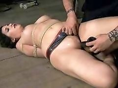 Hogtied lady receives a giant dildo up her twat BDSM