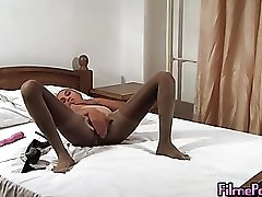 Kinky solo girl covered in pantyhose and masturbating