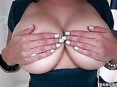 Cutie rubs lotion into her big natural tits