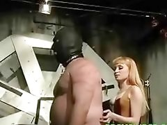 Chubby masked dude whipped and punished by two dominant women
