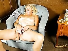 Mommy licks a lollipop fresh from her cunt