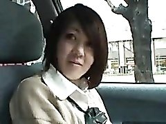 Japanese girl playing naughty in the car