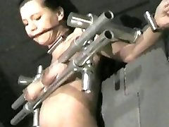 Submissive brunette's boobs are extremely tormented and her body waxed