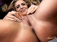 Curly hair milf rubs lotion all over her naked body
