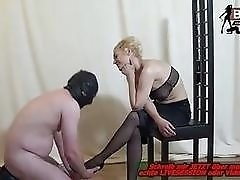 Femdom lady foot worshiped by a perverted slave BDSM porn